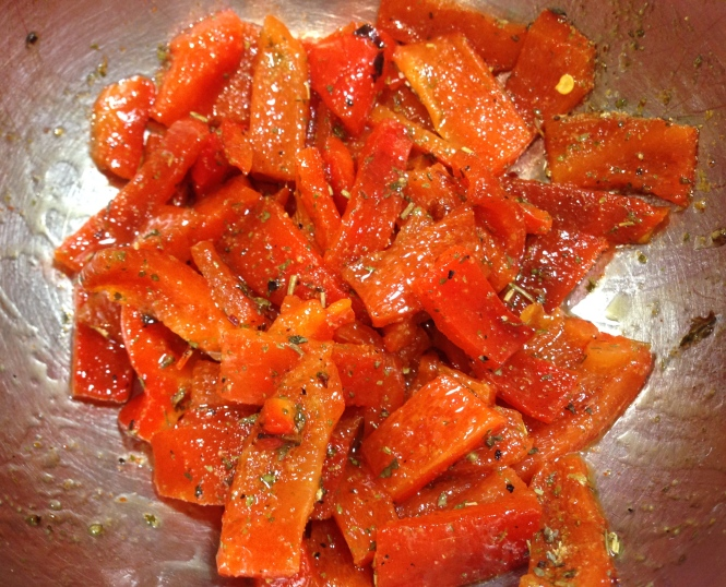 Lardons of red pepper mixed with olive oil and seasonings.