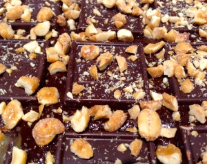 Chocolate squares and peanuts layered in the center of the batter