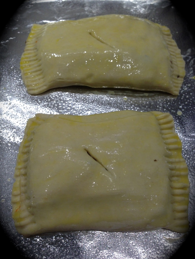 Brush the pastry with an egg wash and cut a slit in the center to release steam