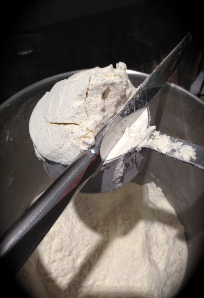 Use a knife to level off the flour...