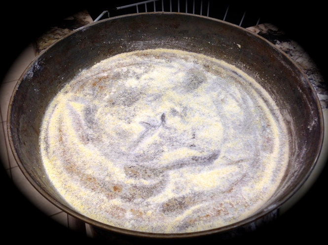 Dust the bottom of the pan with cornmeal...