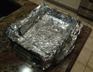 Line the pan with foil and let it overlap the sides to create handles...