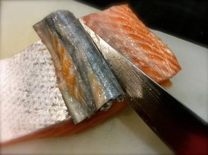 Removing the skin from the salmon