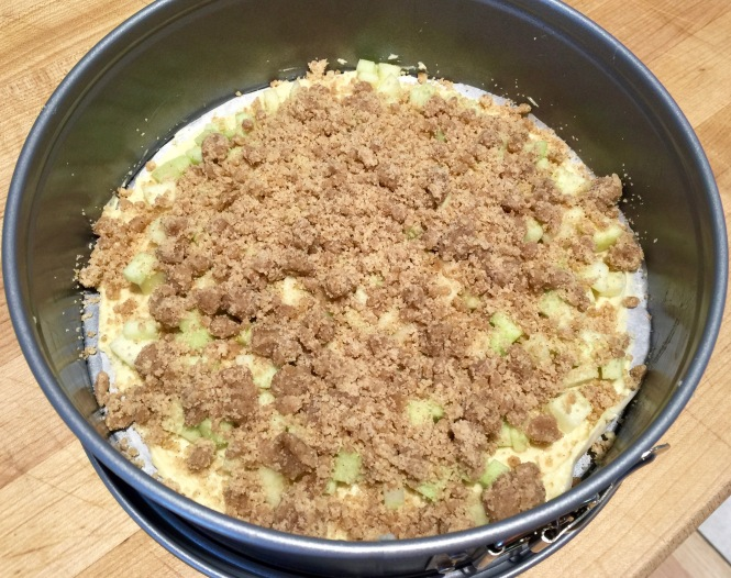 The first layer completed with batter, apples and crumble